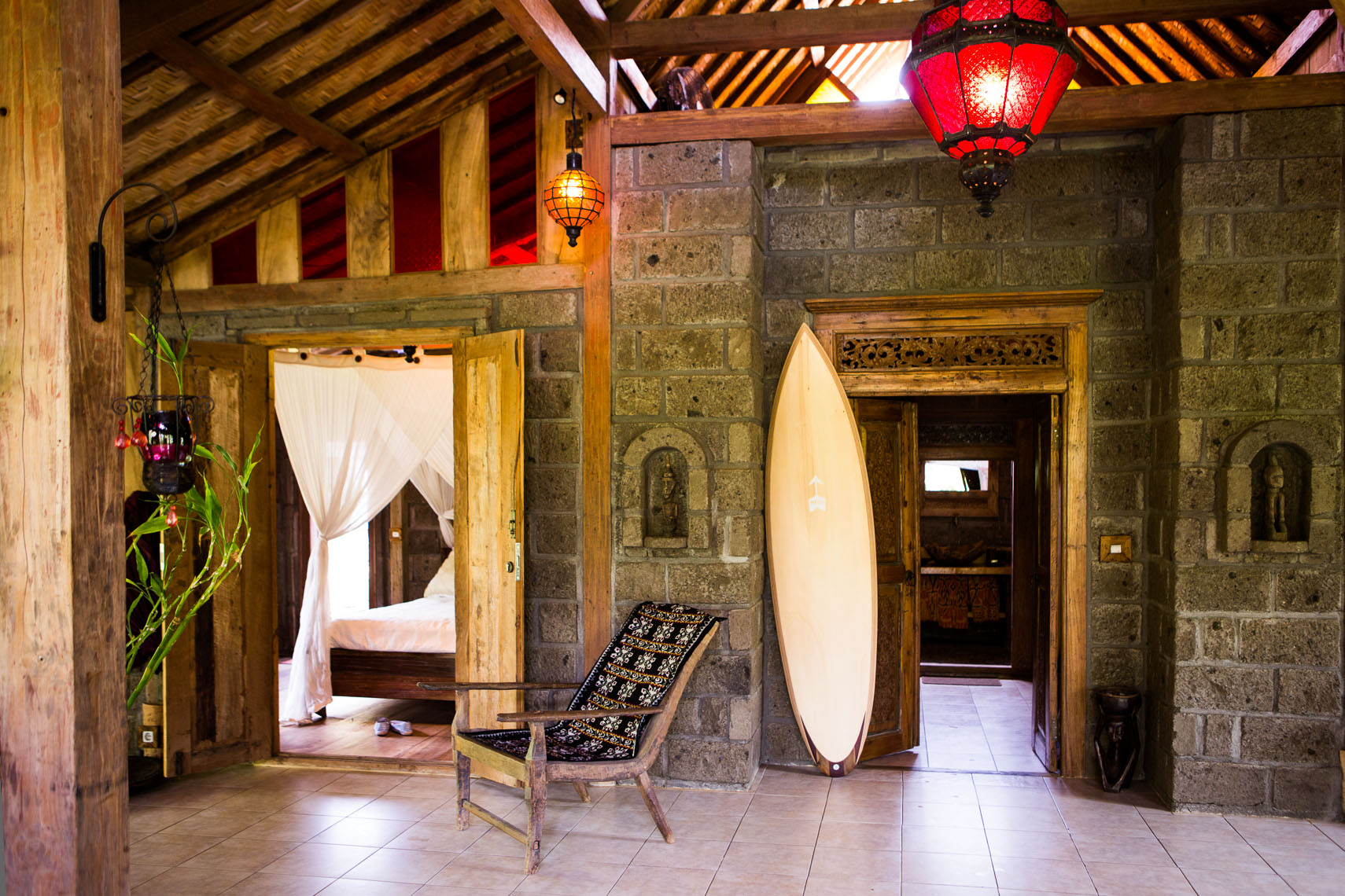 Interior of Balinese house with Hess Surfboard