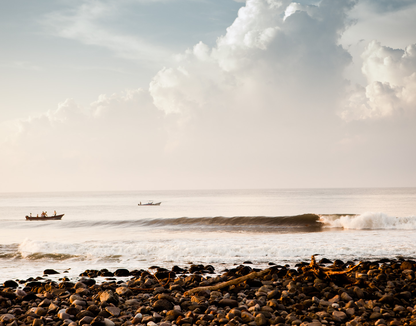 Surfers in perfect wave in El Salvador