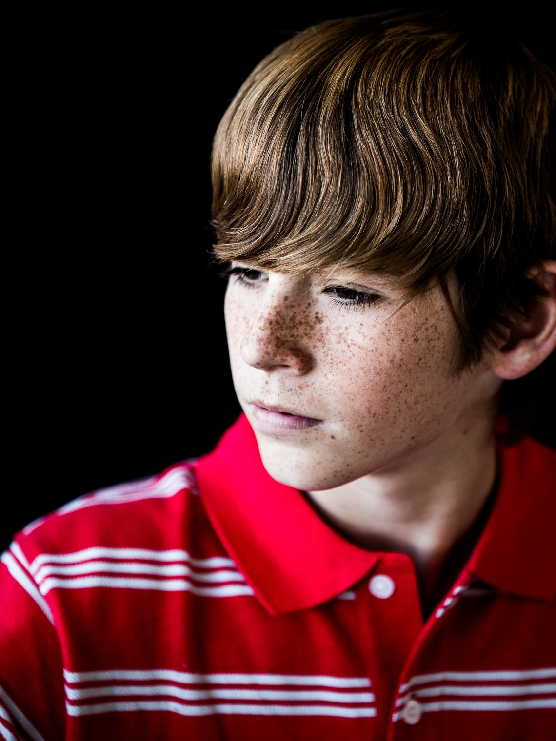 Boy with freckles.